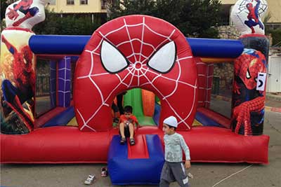 kids bouncy house with spiderman theme
